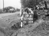 SD741019A, Man marking Ordnance Survey minor control revision point with an arrow in 1940s
