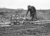 SD741087W, Man marking Ordnance Survey minor control revision point with an arrow in 1950s