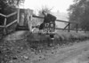 SD731217B2, Man marking Ordnance Survey minor control revision point with an arrow in 1940s