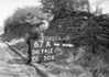 SD741267A, Man marking Ordnance Survey minor control revision point with an arrow in 1950s