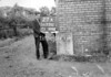 SD731227A, Man marking Ordnance Survey minor control revision point with an arrow in 1950s