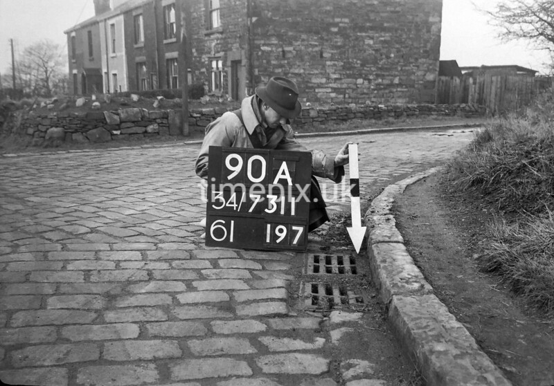 SD731190A, Man marking Ordnance Survey minor control revision point with an arrow in 1950s