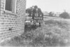 SD721315A, Man marking Ordnance Survey minor control revision point with an arrow in 1940s