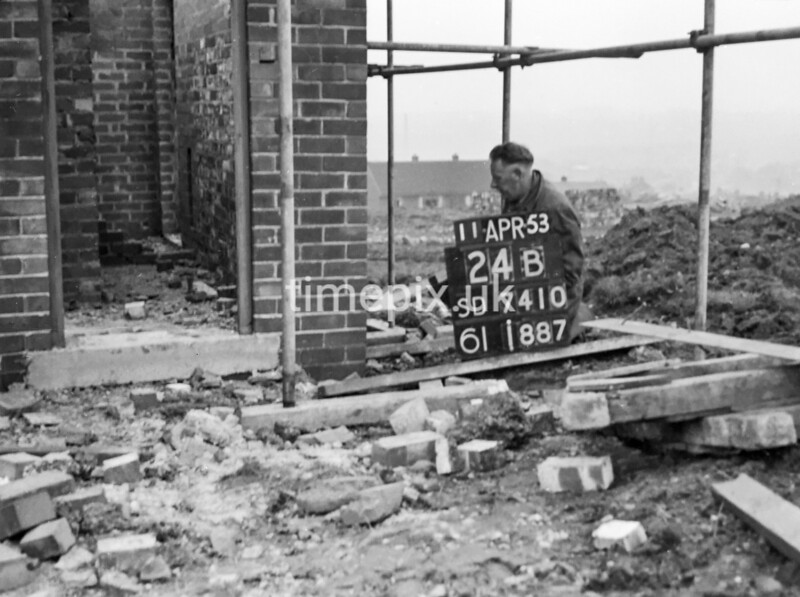 SD741024B, Man marking Ordnance Survey minor control revision point with an arrow in 1950s