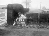 SD741049A, Man marking Ordnance Survey minor control revision point with an arrow in 1940s