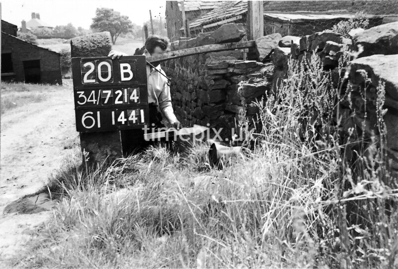 SD721420B, Man marking Ordnance Survey minor control revision point with an arrow in 1950s