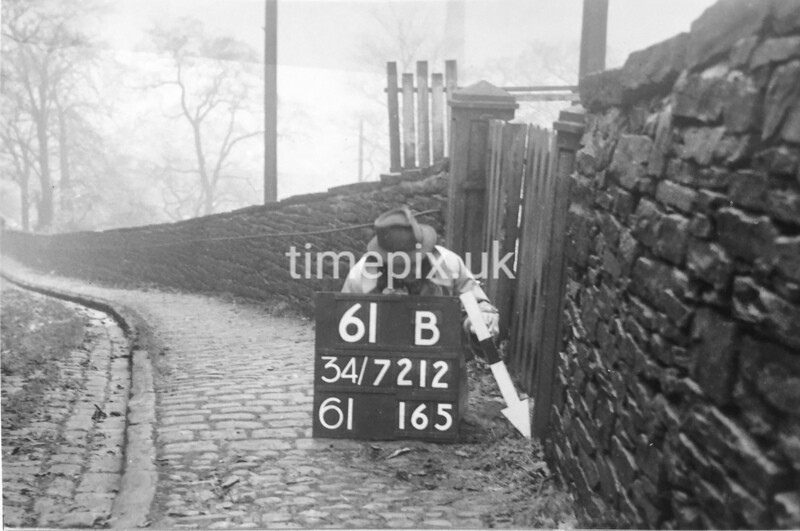 SD721261B, Man marking Ordnance Survey minor control revision point with an arrow in 1940s