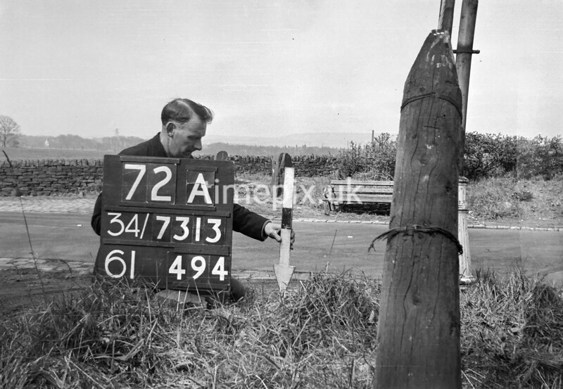 SD731372A, Man marking Ordnance Survey minor control revision point with an arrow in 1940s