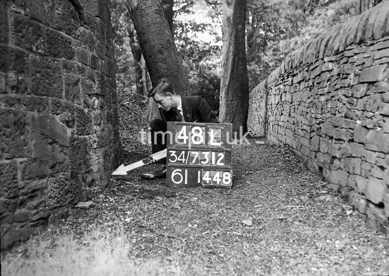SD731248L, Man marking Ordnance Survey minor control revision point with an arrow in 1950s