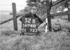 SD741052B, Man marking Ordnance Survey minor control revision point with an arrow in 1940s