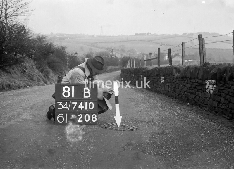 SD741081B, Man marking Ordnance Survey minor control revision point with an arrow in 1940s