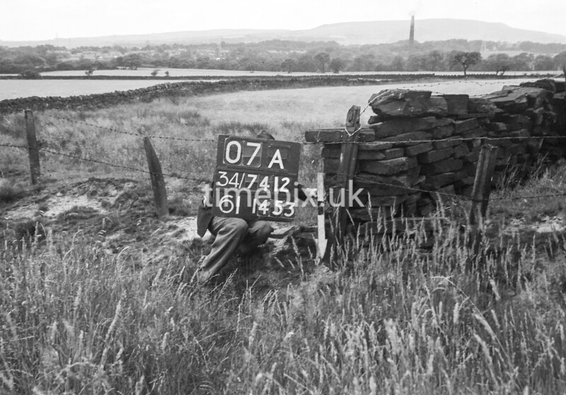 SD741207A, Man marking Ordnance Survey minor control revision point with an arrow in 1950s