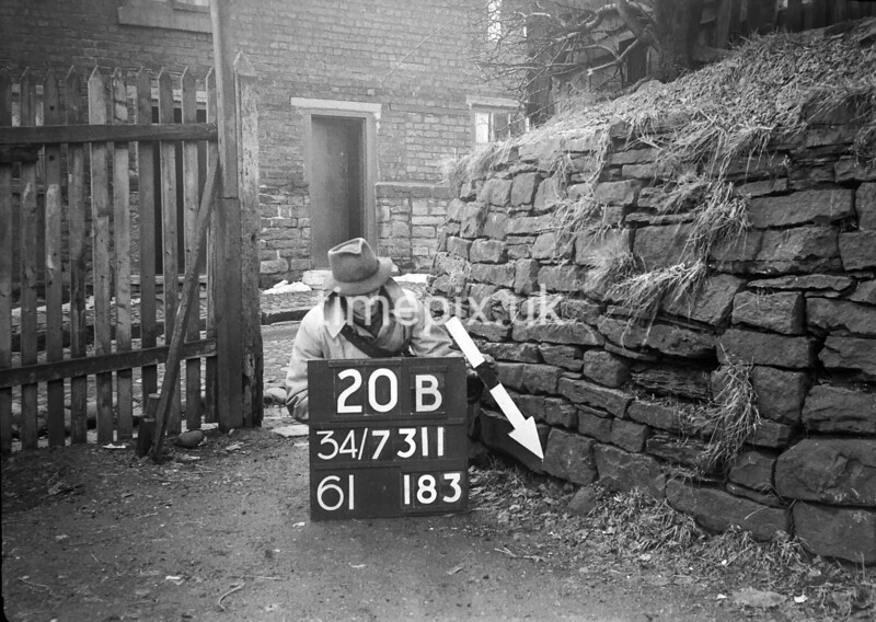 SD731120B, Man marking Ordnance Survey minor control revision point with an arrow in 1940s