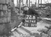 SD741172B, Man marking Ordnance Survey minor control revision point with an arrow in 1940s