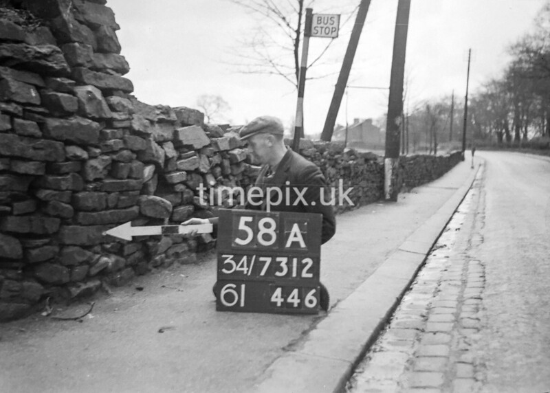 SD731258A, Man marking Ordnance Survey minor control revision point with an arrow in 1940s