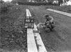SD741044A, Man marking Ordnance Survey minor control revision point with an arrow in 1950s