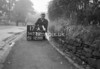 SD731217A2, Man marking Ordnance Survey minor control revision point with an arrow in 1940s