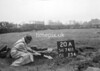SD741120A, Man marking Ordnance Survey minor control revision point with an arrow in 1940s