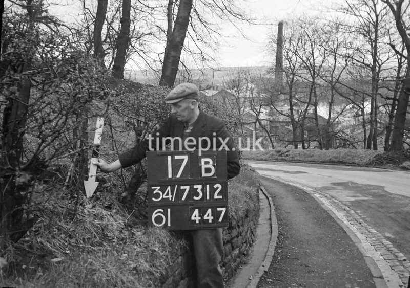 SD731217B1, Man marking Ordnance Survey minor control revision point with an arrow in 1940s