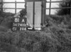 SD741081A, Man marking Ordnance Survey minor control revision point with an arrow in 1940s