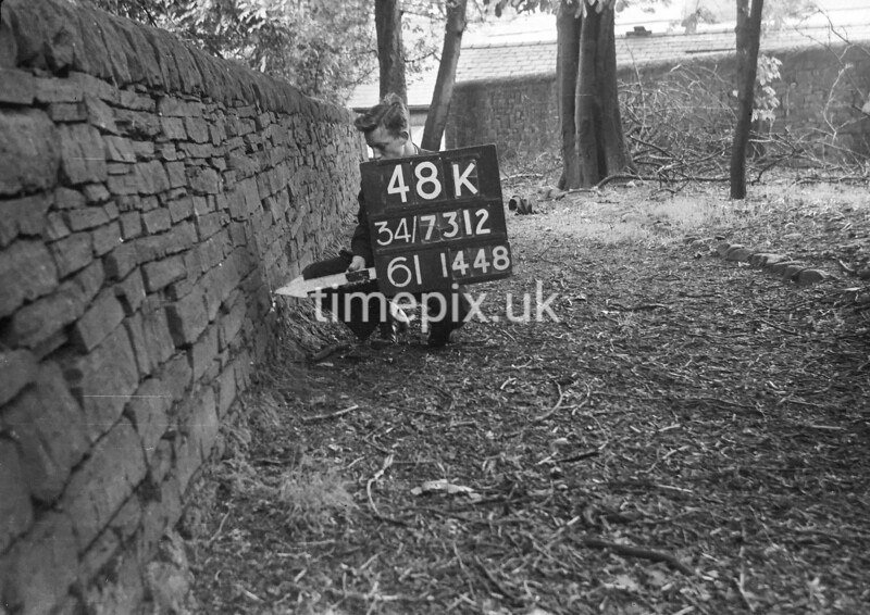 SD731248K, Man marking Ordnance Survey minor control revision point with an arrow in 1950s