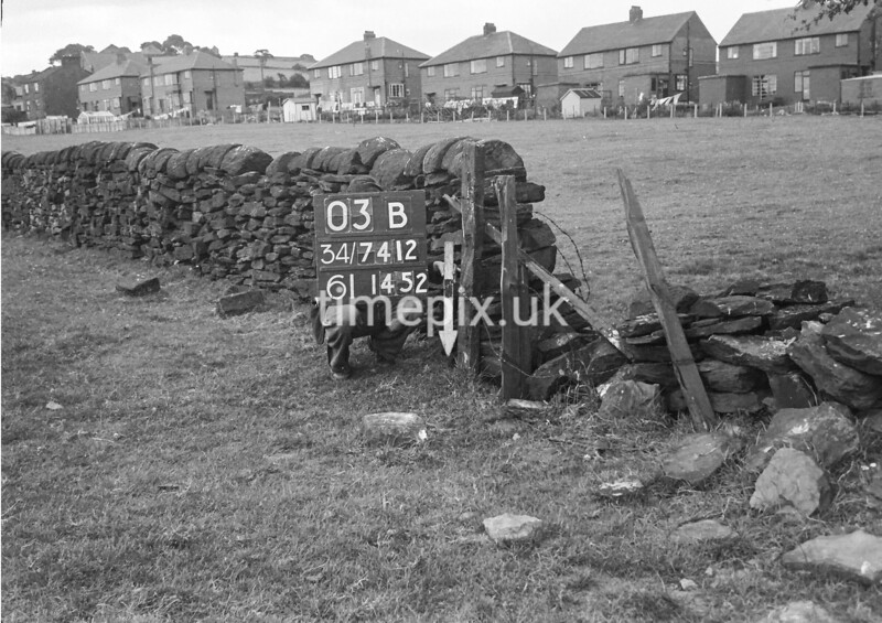 SD741203B, Man marking Ordnance Survey minor control revision point with an arrow in 1950s