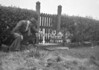 SD731213A, Man marking Ordnance Survey minor control revision point with an arrow in 1940s
