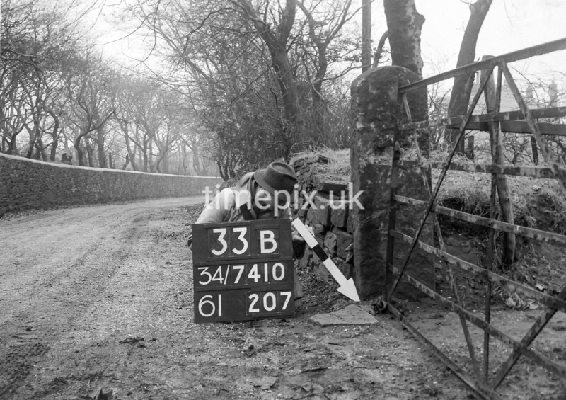 SD741033B, Man marking Ordnance Survey minor control revision point with an arrow in 1940s