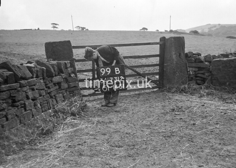 SD731299B, Man marking Ordnance Survey minor control revision point with an arrow in 1950s