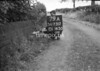 SD731279A, Man marking Ordnance Survey minor control revision point with an arrow in 1950s