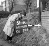 SD741051A, Man marking Ordnance Survey minor control revision point with an arrow in 1940s