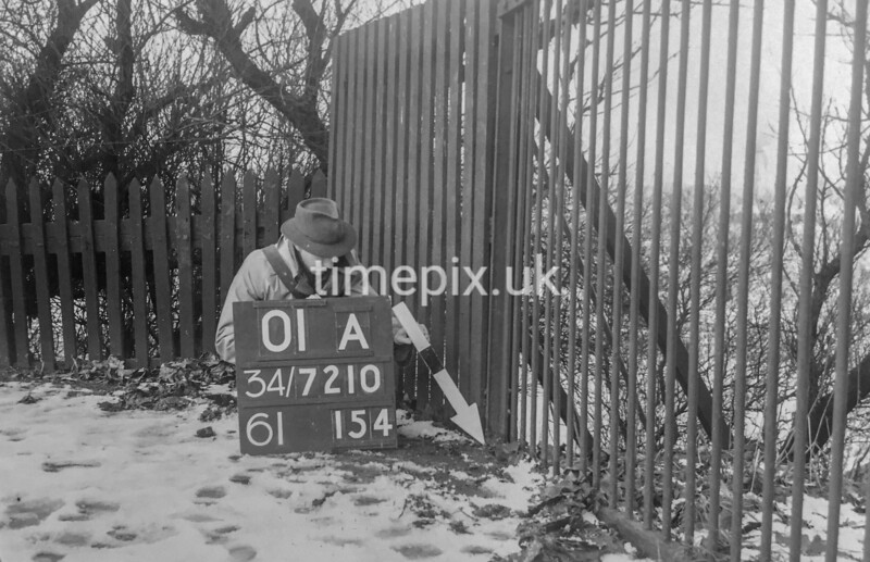 SD721001A, Man marking Ordnance Survey minor control revision point with an arrow in 1940s
