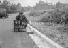 SD731093A, Man marking Ordnance Survey minor control revision point with an arrow in 1940s