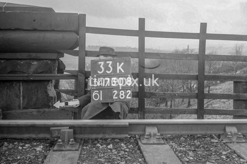 SD730833K, Man marking Ordnance Survey minor control revision point with an arrow in 1940s