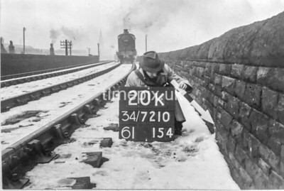 SD721020K, Man marking Ordnance Survey minor control revision point with an arrow in 1940s