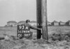 SD740493A, Man marking Ordnance Survey minor control revision point with an arrow in 1940s