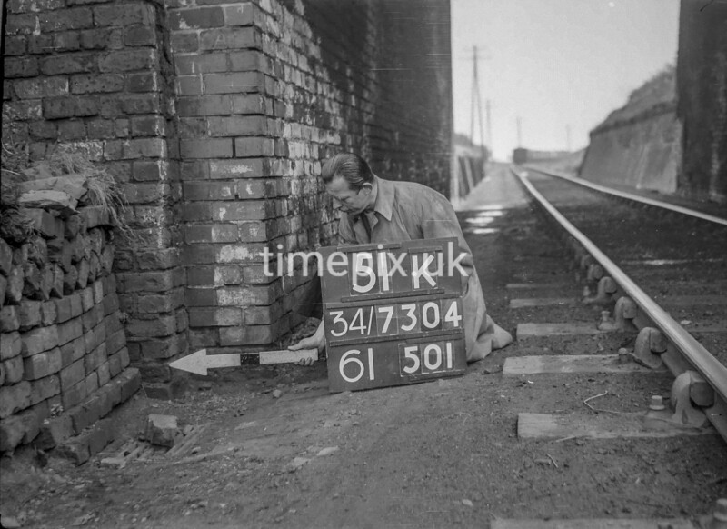 SD730451K, Man marking Ordnance Survey minor control revision point with an arrow in 1940s