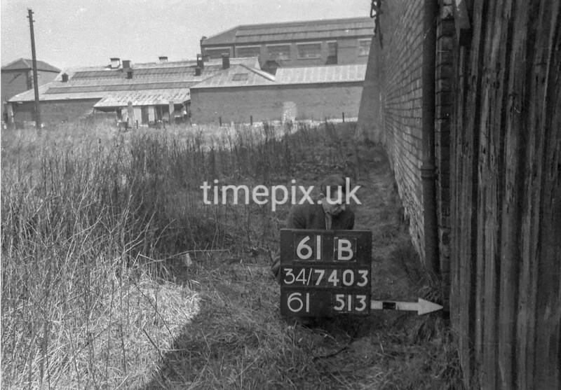 SD740361B1, Man marking Ordnance Survey minor control revision point with an arrow in 1940s