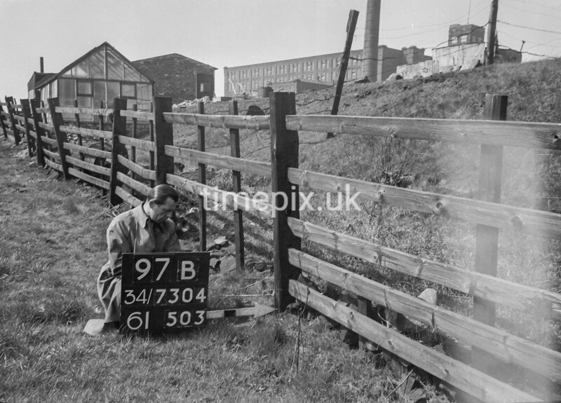SD730497B, Man marking Ordnance Survey minor control revision point with an arrow in 1940s