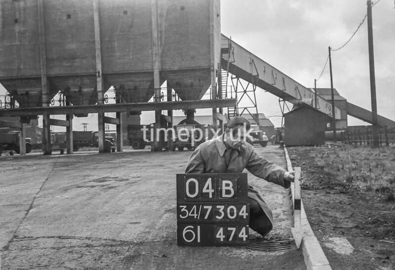 SD730404B, Man marking Ordnance Survey minor control revision point with an arrow in 1940s