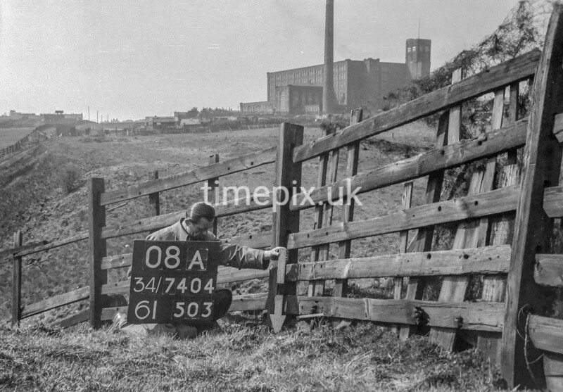 SD740408A, Man marking Ordnance Survey minor control revision point with an arrow in 1940s