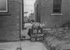 SD730418A, Man marking Ordnance Survey minor control revision point with an arrow in 1940s