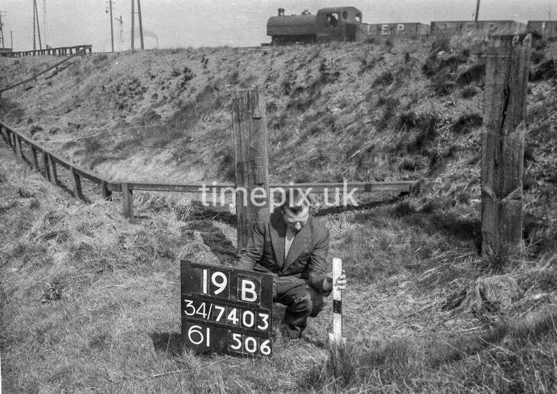 SD740319B, Man marking Ordnance Survey minor control revision point with an arrow in 1940s