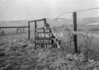 SD730514A, Man marking Ordnance Survey minor control revision point with an arrow in 1940s