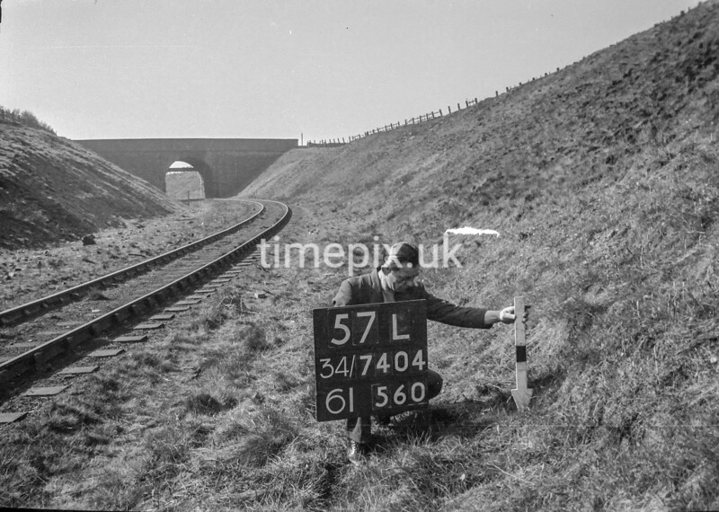 SD740457L, Man marking Ordnance Survey minor control revision point with an arrow in 1940s