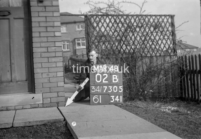 SD730502B, Man marking Ordnance Survey minor control revision point with an arrow in 1940s