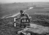 SD740568A, Man marking Ordnance Survey minor control revision point with an arrow in 1940s