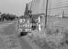 SD730397A, Man marking Ordnance Survey minor control revision point with an arrow in 1940s