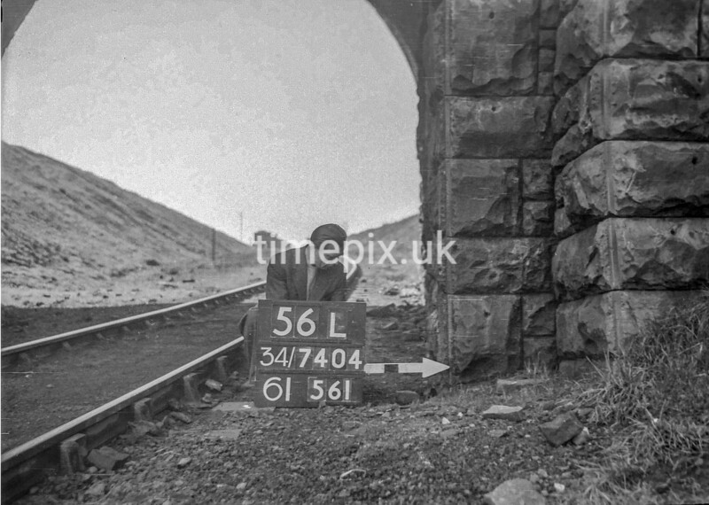 SD740456L, Man marking Ordnance Survey minor control revision point with an arrow in 1940s
