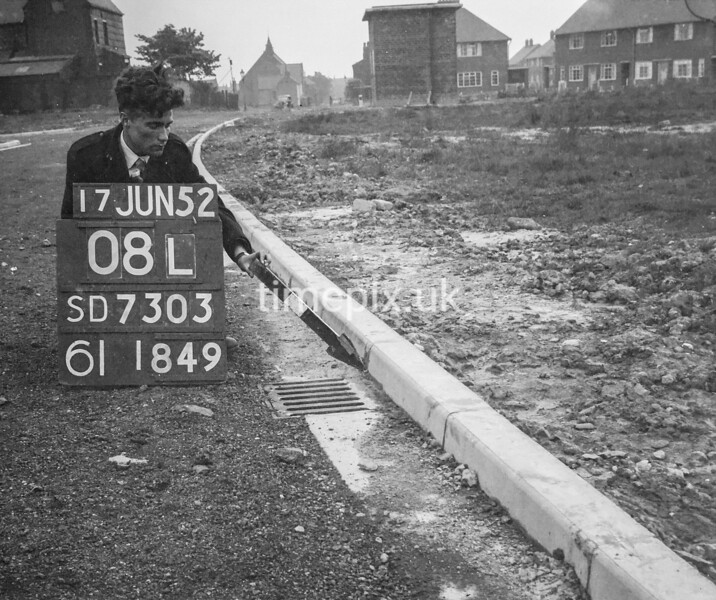 SD730308L, Man marking Ordnance Survey minor control revision point with an arrow in 1950s